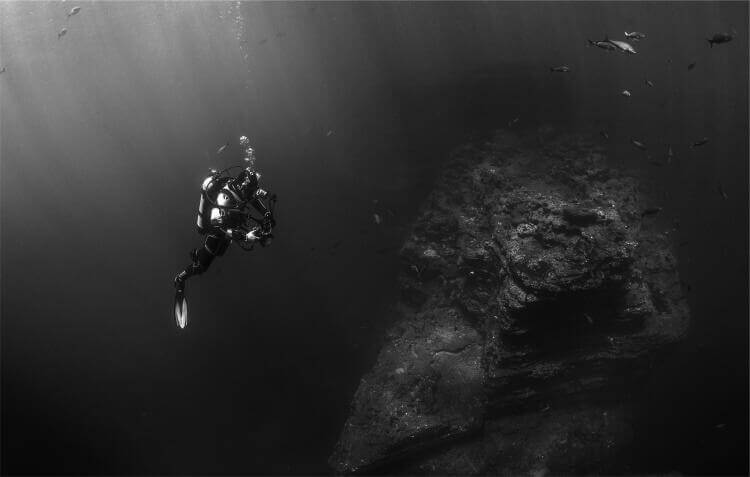 Scuba Diver exploring one of the many wrecks in Phuket