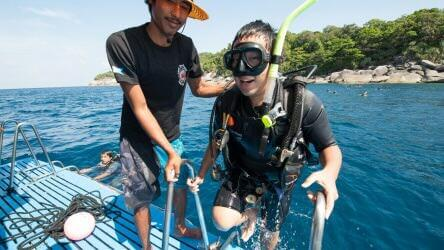 Happy customer returning after an amazing scuba dive with Local Dive Thailand