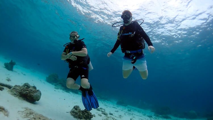 father and son practising scuba diving skills